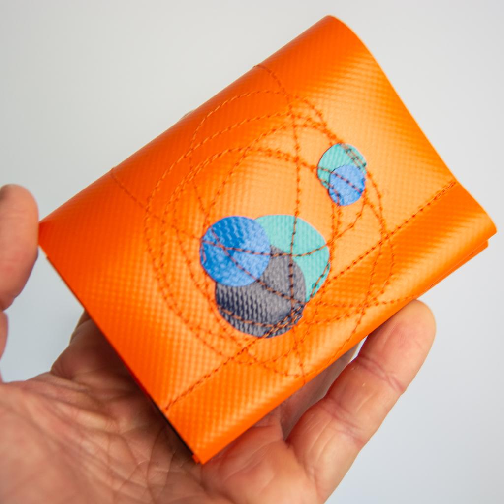 minigeldbeutel mit kreisen orange